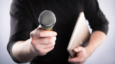 Male hand with notebook and with microphone.  High image resolution. 3D