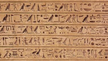 Egyptian hieroglyphics stone background