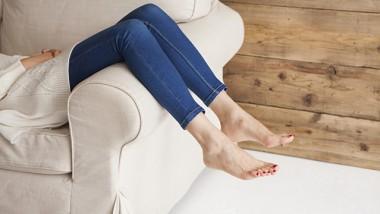 Feet of the woman lying on the sofa