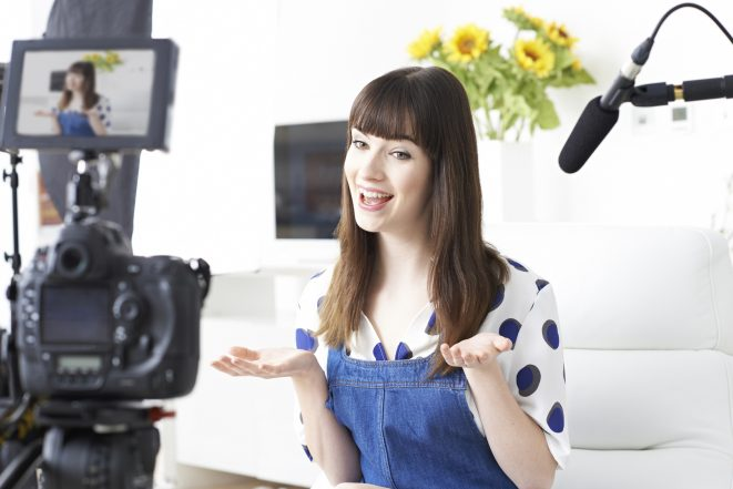 how to make videos - female vlogger on camera