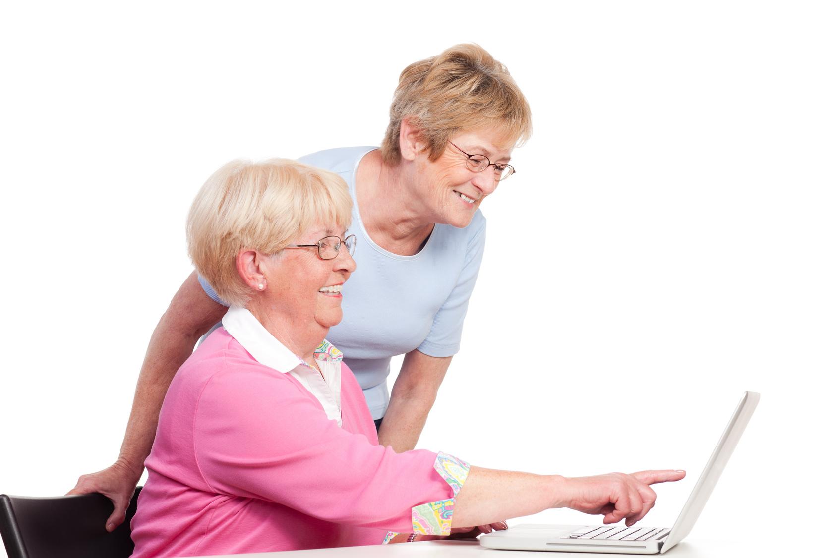 Two older women looking at laptop