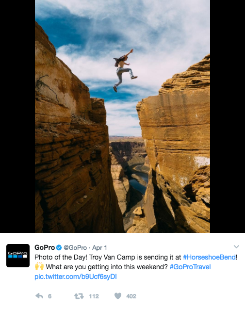 GoPro Twitter handle of man jumping from one cliff to another