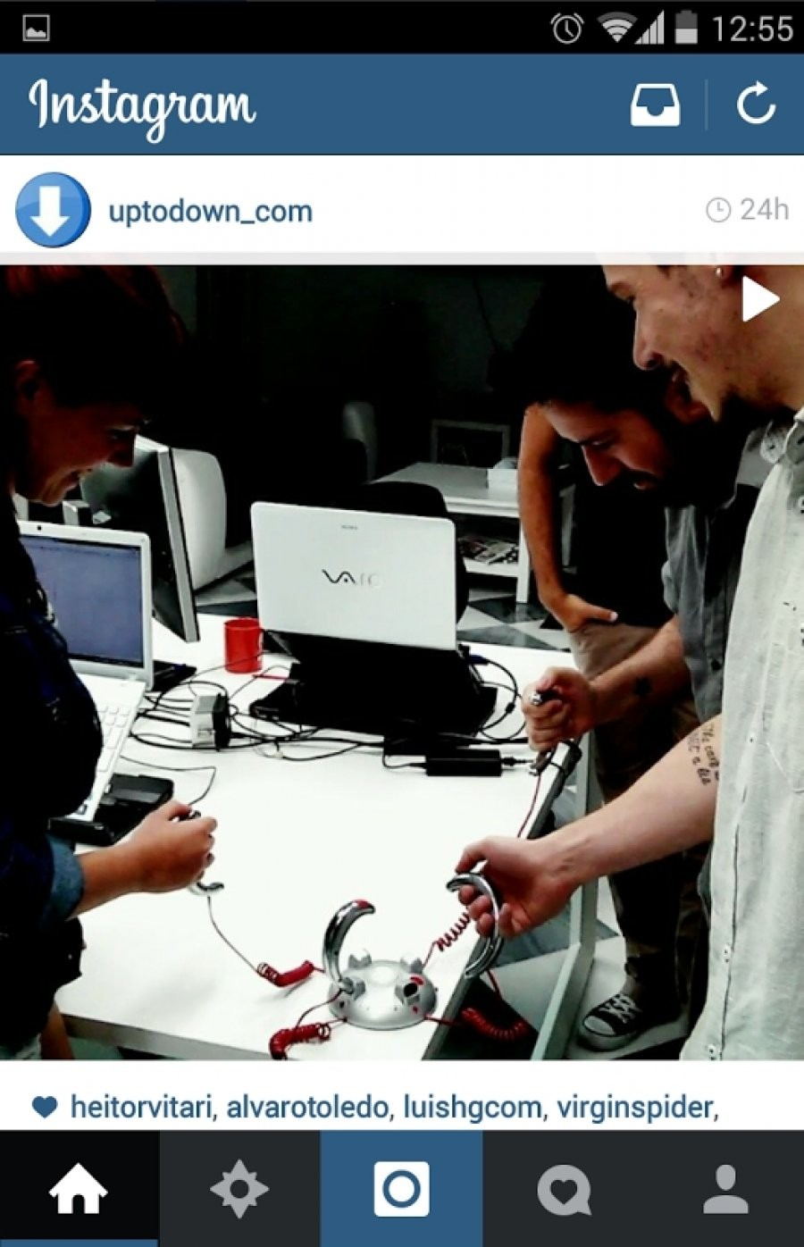 Instagram campaign with image of people playing with electronic device